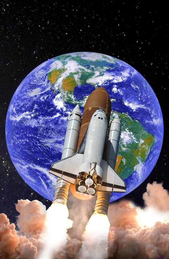 Space shuttle launch in the open space over the Earth. Spaceship taking off on a mission. Elements of this image furnished by NASA stock photography