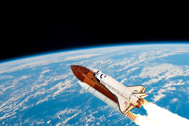 A space shuttle takes off into Earth orbit to mission on mars.Elements of this image furnished by NASA stock photos