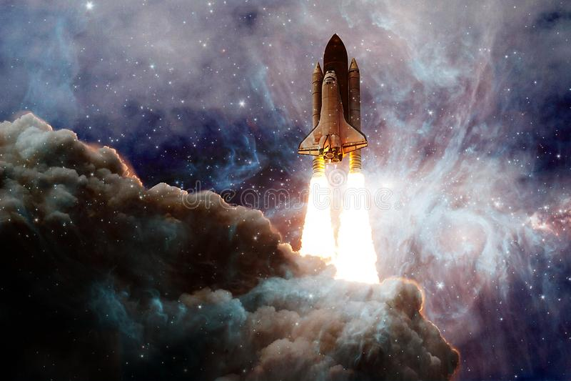 Space shuttle taking off on a mission. Deep space. Beauty of endless universe. Elements of this image furnished by NASA royalty free stock photos