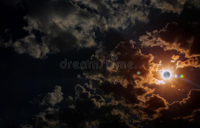 Space solar eclipse sunrise view from moon with dramatic cloud royalty free stock photo