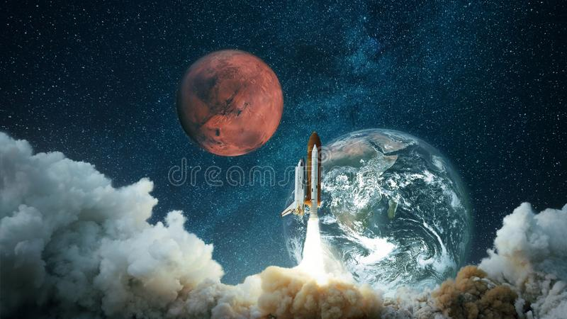 Spacecraft takes off into the starry sky with the planet Earth and the planet Mars. Rocket flies to the planet. royalty free stock image