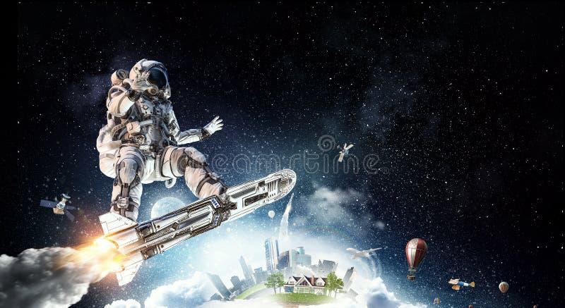 Spaceman στον πετώντας πίνακα Μικτά μέσα στοκ εικόνες