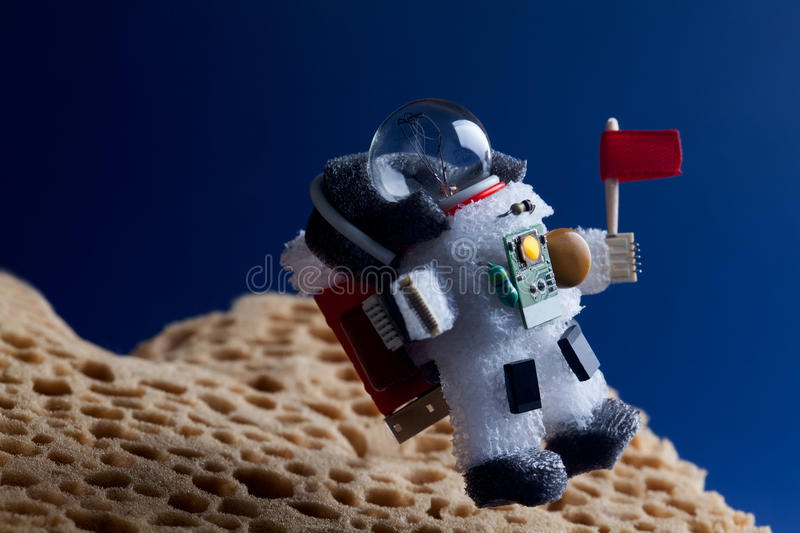 Spaceman floating stratosphere, planet blue sky background. Light bulb character dressed in spacesuit astronaut stock images