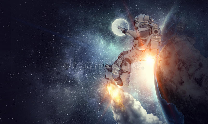 Spaceman on flying board. Mixed media royalty free stock photography