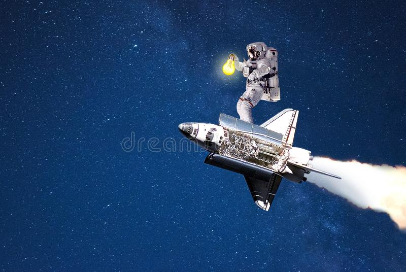 Spaceman flying on spacecraft search route in galaxy. Elements of this image furnished by NASA royalty free stock image