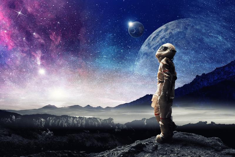 Spaceman and planets abstract theme stock images