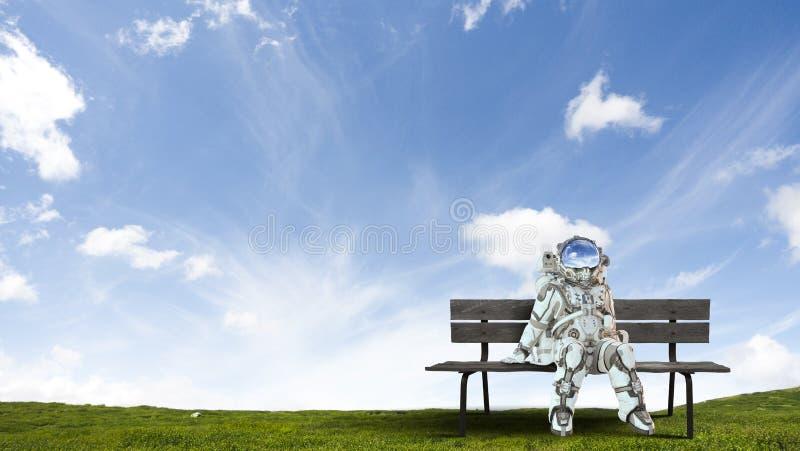 Rocketman on bench. Mixed media stock photography