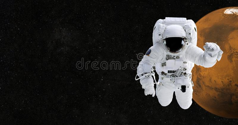 Spaceman travels to Mars. Astronaut in space against royalty free stock photo