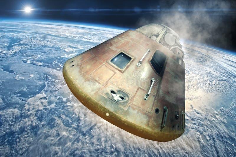 Spaceship approaches the earth stock photos