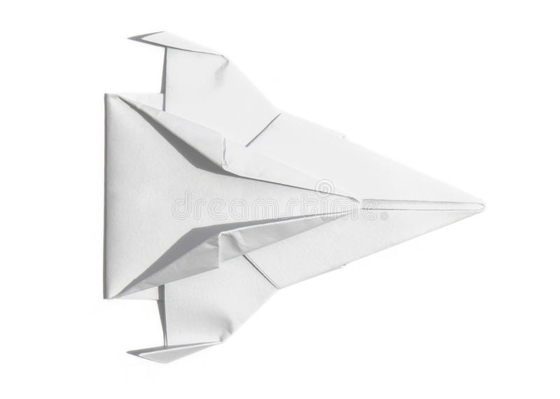 Spaceship of paper overhead view. Overhead view of a nice origami spaceship isolated over a sheet of paper stock image
