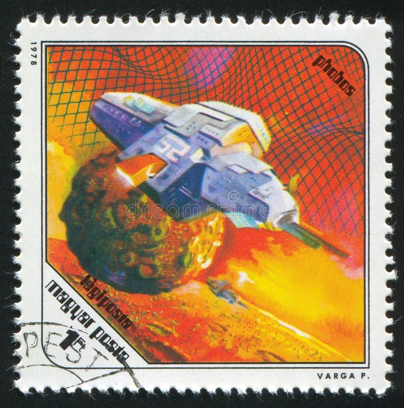 Spaceship and Phobos royalty free stock image