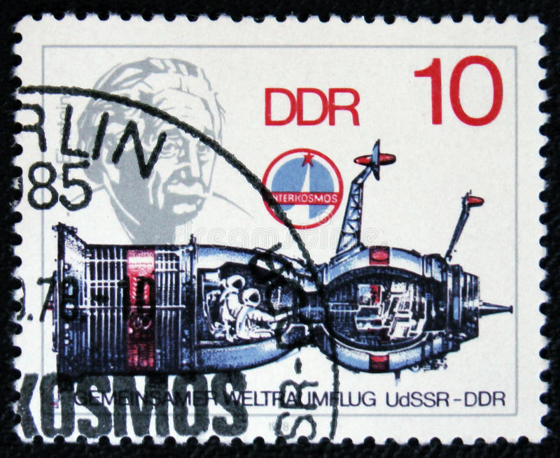 Spaceship and portrait of scientist Albert Einstein, circa 1979. MOSCOW, RUSSIA - JANUARY 7, 2017: A post stamp printed in Germany shows spaceship and portrait royalty free stock image