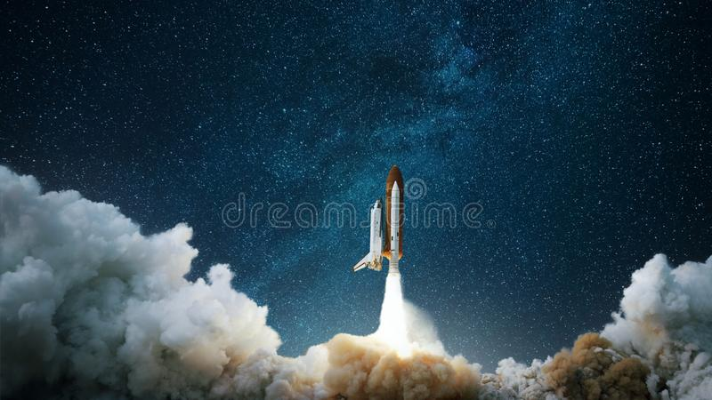 Spaceship takes off into the starry sky. Rocket starts into space. Concept. royalty free stock photography