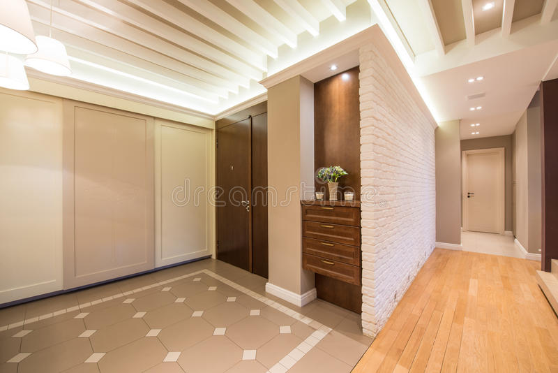 Spacious anteroom interior in warm tones and modern ceiling lights stock photography