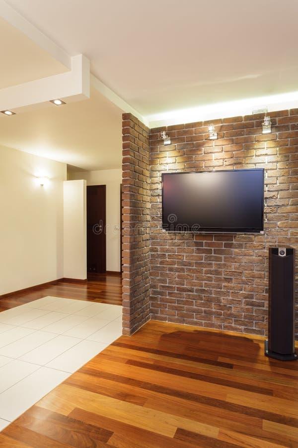 Spacious apartment - brick wall royalty free stock image