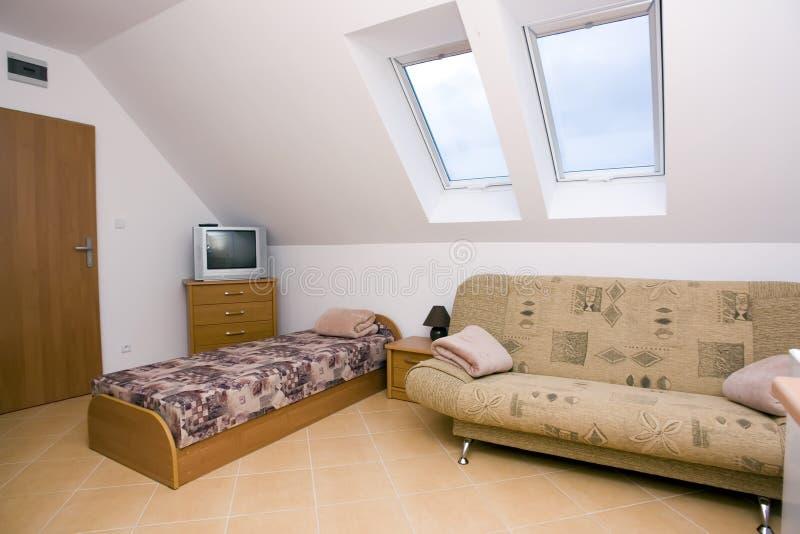 Spacious attic bedroom royalty free stock photos