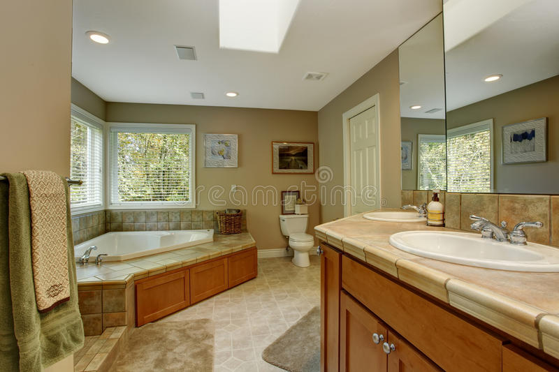 Spacious bathroom with corner bath tub royalty free stock images