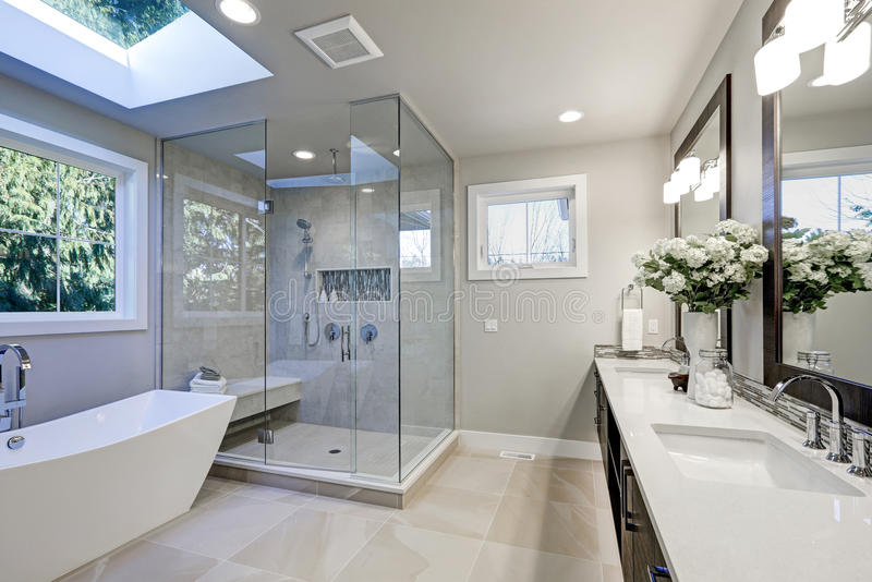 Spacious bathroom in gray tones with heated floors royalty free stock image