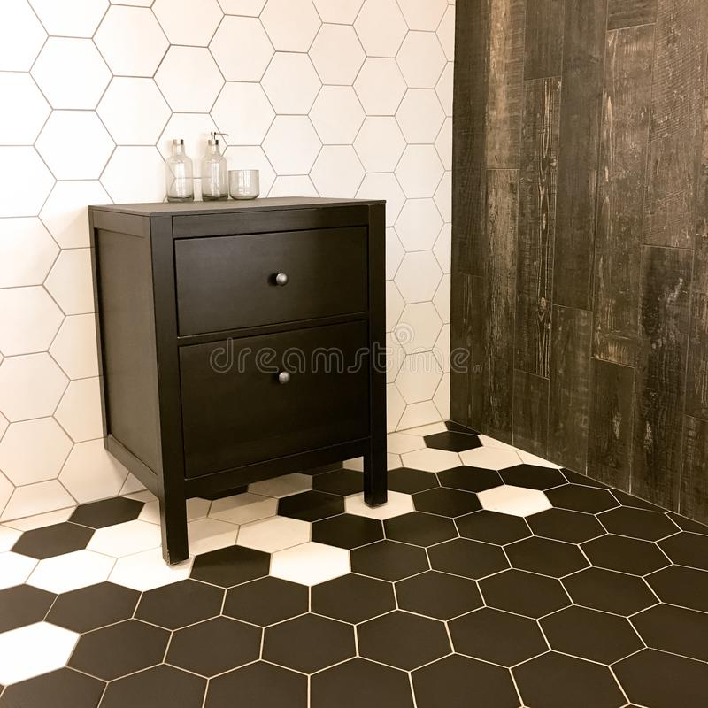 Spacious bathroom with tiled floor and black drawer unit stock photography