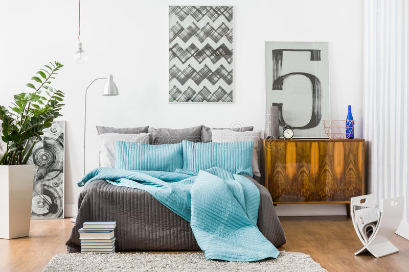 Spacious bedroom with modern furniture. Image of spacious bedroom with modern stylish furniture royalty free stock photography