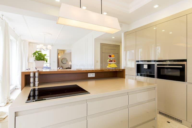 Spacious beige kitchen stock photos