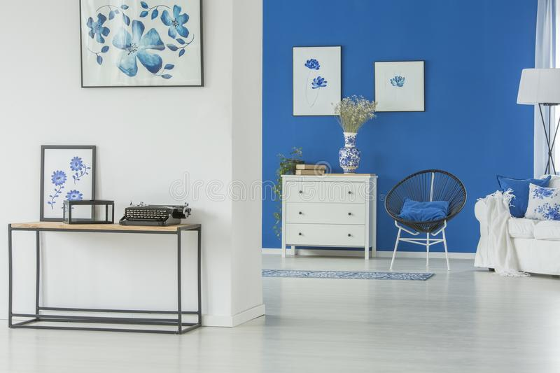 Spacious blue living room stock photography