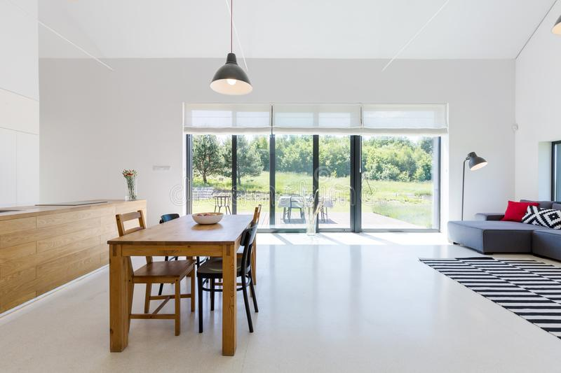Open space with dining area stock photos