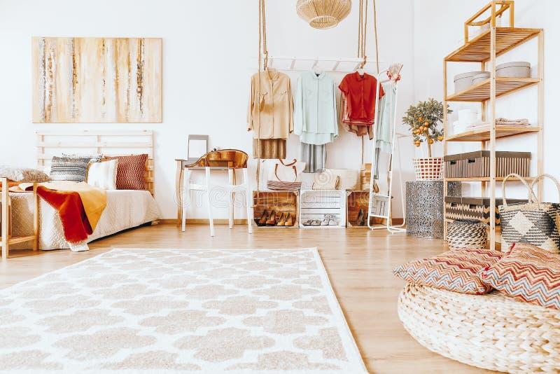 Spacious cozy bedroom. Tidy spacious cozy bedroom in warm sandy colors with modern wardrobe stock photo