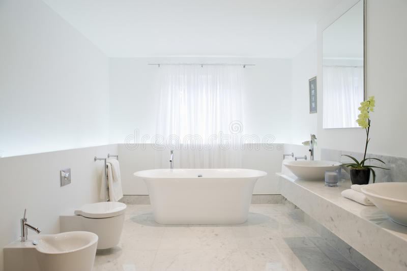Spacious And Elegant Bathroom stock photos