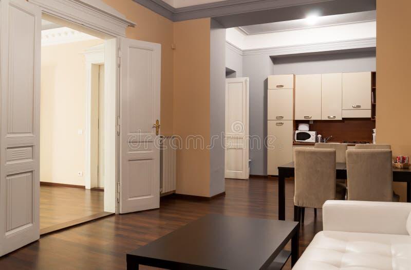 Spacious hotel apartment with kitchen royalty free stock photos