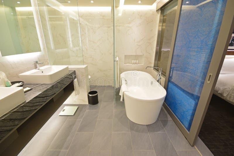 Spacious Hotel Suite Bathroom with sliding door stock photo