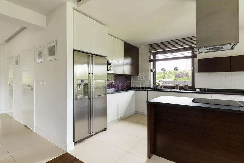 Spacious kitchen in modern house royalty free stock photo