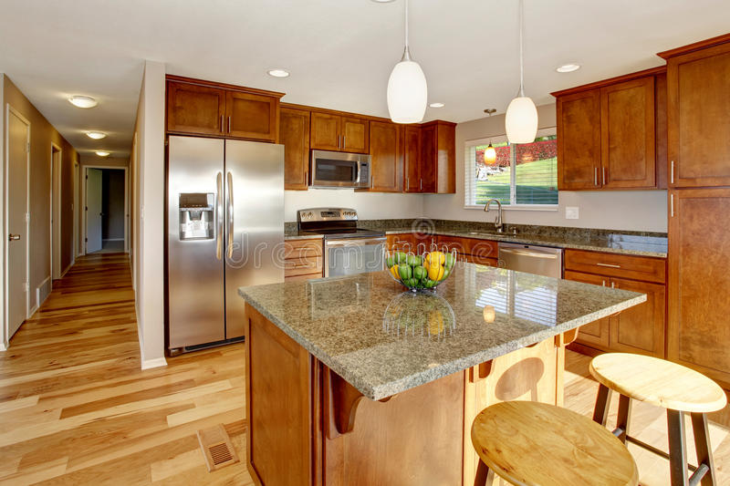 Spacious kitchen room with bar, stainless steel appliances and pendant lights. Spacious kitchen room with bar, stainless steel appliances, granite counter tops stock image