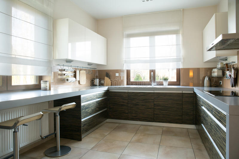 Spacious kitchen with window stock images