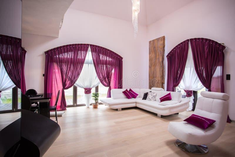 Spacious and modern living room stock image