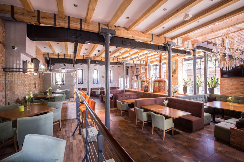 Spacious modern restaurant. Interior of spacious modern restaurant with wooden floor royalty free stock image