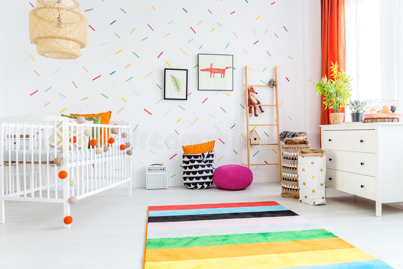 Spacious room for kids. Spacious white room with cradle designed for kids stock images