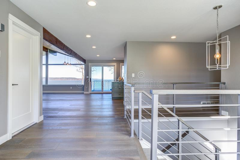 Spacious upstairs landing with gray walls stock images