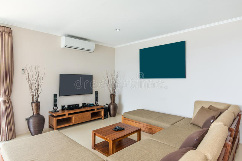 Spacious Villa Interior and living room. Beautiful living room villa interior in Bali property, white color style, wooden chair and sofa royalty free stock photo