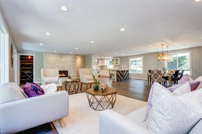 Spacious white living area with stone fireplace. Spacious white living area with stone wall fireplace royalty free stock images