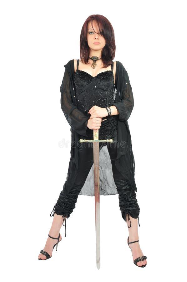 Spada attraente della stretta della ragazza in sue mani fotografia stock libera da diritti