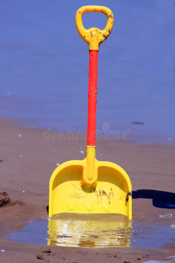 Download Spade on the beach stock photo. Image of unearth, beach - 11343740