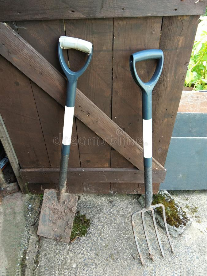 Spade and digging fork stock photography