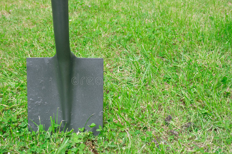 Spade in the ground royalty free stock image