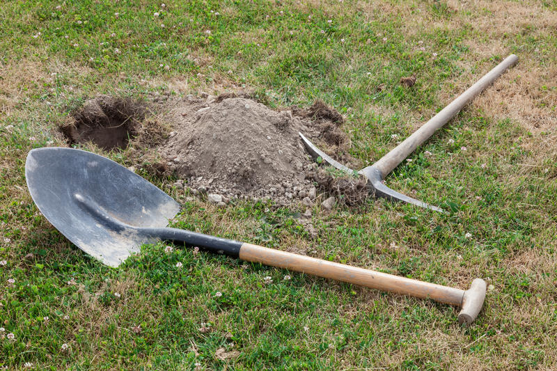 Download Spade And Pick On The Grass Stock Image - Image: 25192463