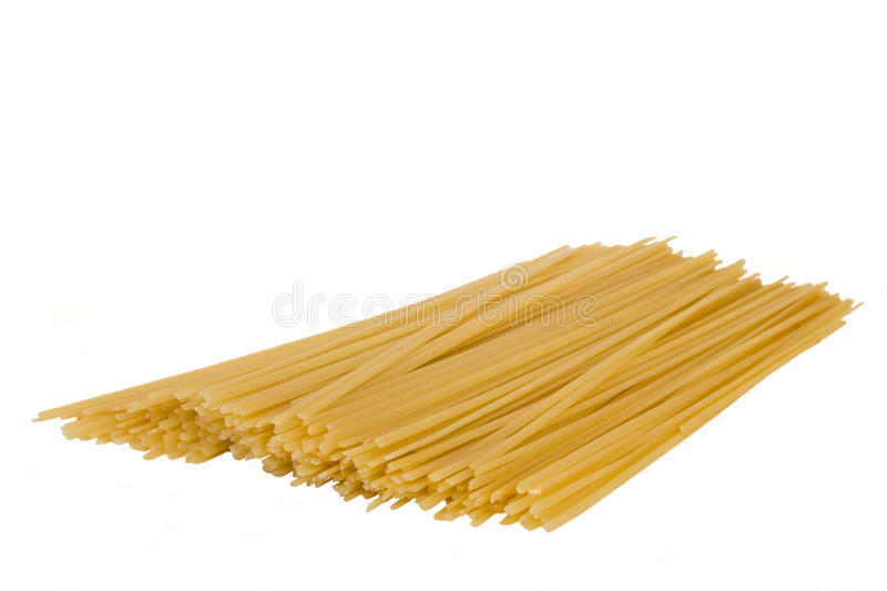 Spagetti. Raw spagetti in isolated over white stock image