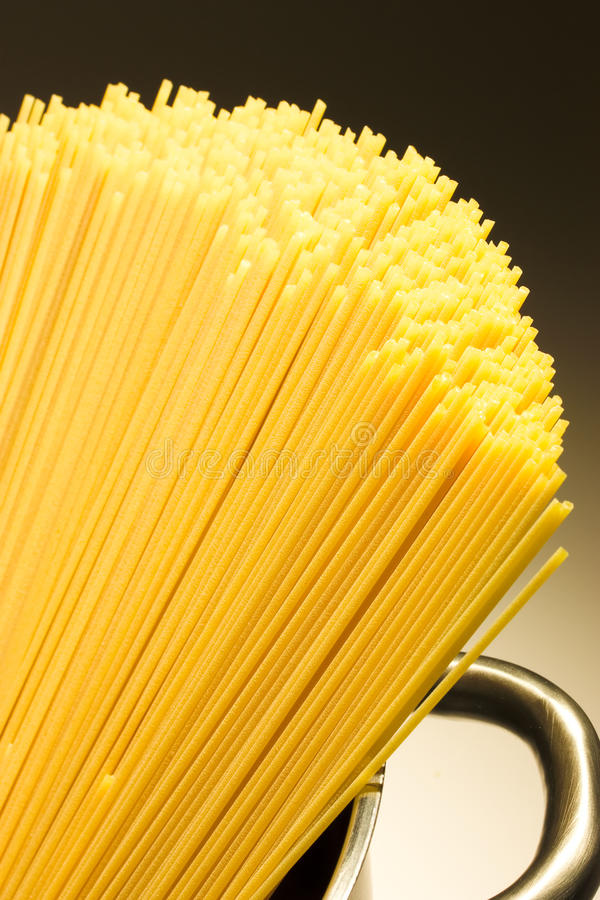 Spagetti. In a pot waiting to be cooked royalty free stock images