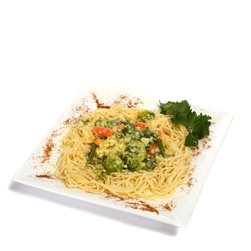 Spagetti. In rectangular plate isolated on white royalty free stock image