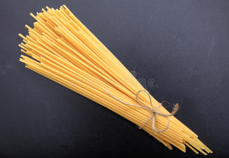 Spagetti on black background. Spagetti pasta on black background royalty free stock photography