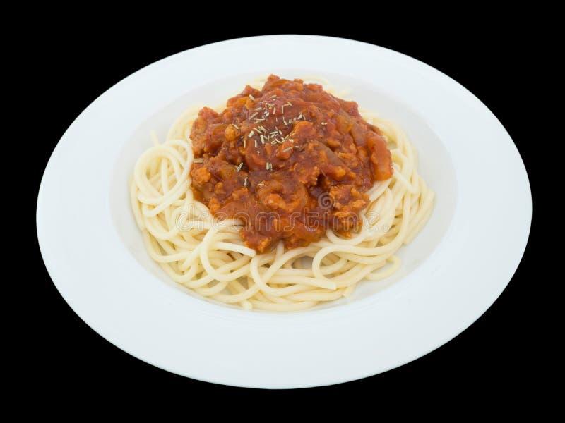 Spagetti bolognese på en platta som isoleras på den svarta bakgrunden royaltyfri fotografi